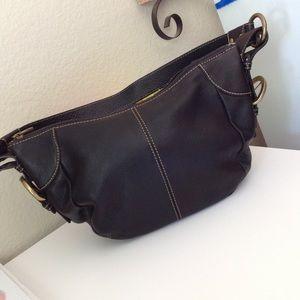 Black fossil shoulder bag with brass hardware